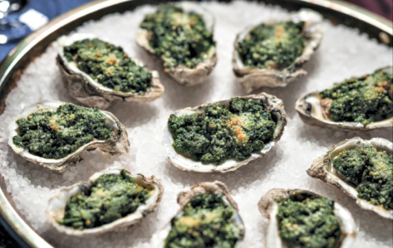 Baked Oysters, wilted greens and herbs topped with bread crumbs