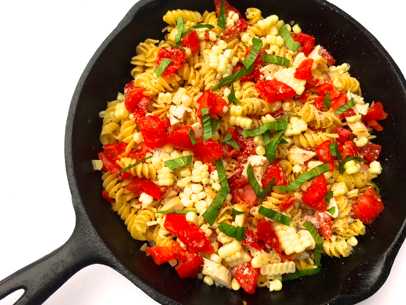 Fresh sweet corn and vegetables with pasta and chicken
